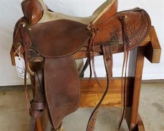 "237	  KM Saddlery Rope Saddle 16"" KM Saddlery Rope Saddle of Chowchilla.Ca. Serial # 143. Sterling silver conchos. Has 4"" rawhide pencil roll cantle.  All rigging is complete. ACTRA breast collar.  Has rawhide swell. In very good working condition. Has makers mark on saddle."