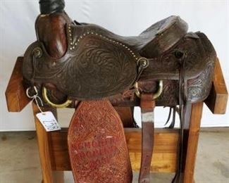 "238	  Western Roping Saddle 16"" Western Roping Saddle with almost matching stirrup fenders.  vintage conchos and buck stitched seat."