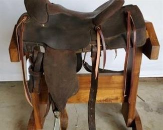 "242	  Western Roping Saddle 15"" Western Roping Saddle with a 5"" horn top. Long string ties and rear cinch. In using condition."