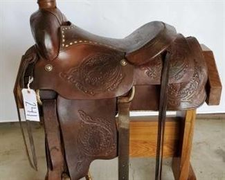 "241	  Western Roping Saddle with Buck Stitching 16 1/2"" Western Roping Saddle.  Has buck stitching in seat and vintage conchos.  Long string ties and front and back cinch.  In using condition."
