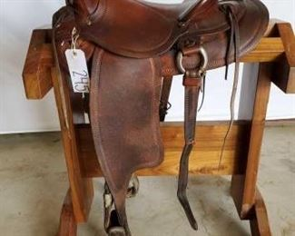 "245	  Vintage Buckaroo Western Saddle 14"" Vintage Buckaroo Western Saddle. Serial # #8 3970.  Saddle has a 3"" pencil roll cantle.  Front and rear cinch.  This saddle is in good condition and real cute too."
