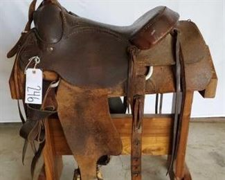 "246	  Western Roping Saddle 16"" double bull hide Western Roping Saddle. Has a complete rigging.  The breast collar is a Billy Cook. Also complete with rawhide covered stirrups. Saddle is in working condition."