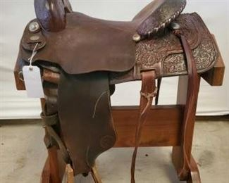 "247	  Circle Y Brand Western Saddle 16"" Circle Y Brand Western Saddle.  Performance saddle with silver conchos and silver laced cantle.  Needs some small repair but otherwise in good condition."
