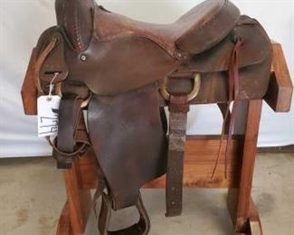 "274	  Cowboy Riding Saddle 16"" Cowboy Riding Saddle.  Serial # 717.  This saddle is in using condition."