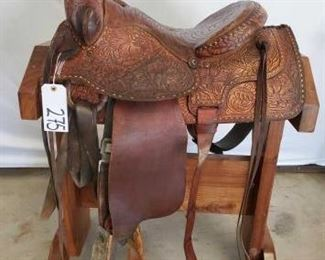 "275	  Cowboy Rope Saddle with Buck Stitching 15"" Cowboy Rope Saddle with lots of buck stitching.  Long string ties and ready to ride with a couple of parts."