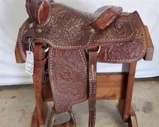 "279	  Cowboy Western Saddle 15 1/2"" Cowboy Western Saddle. Serial # 502.  Lots of buck stitching all around.  Vintage conchos.   Complete rigging.  Ready to ride."