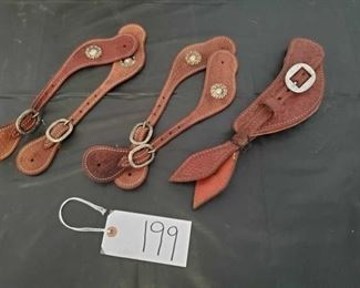 199	  Three Sets of Leather Spur Straps with some silver conchos Three Sets of, never used Leather Spur Straps with some silver conchos and buckles.