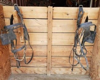 307	  Two Draft Horse Bridles and Reins for a Team Two Draft Horse Bridles for a Team Made of black patent leather  Leather is dusty in pictures