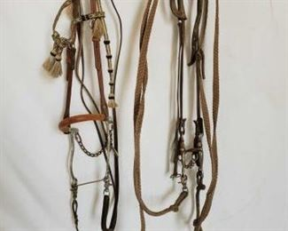 126	  Complete Horsehair Headstall Hackamore Bit Bridle and a Bridle with a Tom Thumb Snaffle Bit Complete Hackamore Bit Bridle and a Bridle with a Tom Thumb Snaffle Bit.  Nice horsehair headstall on the hackamore bridle