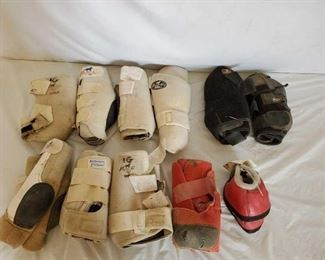 442	  Lots of Name Brand Splint Boots and single pair of Red Bell Boots 10 + or - Front and Back Splint Boots Lots of Name Brand Splint Boots.  Pro Choice-Classic Equine Fronts and backs also included are a red pair of bell boots.