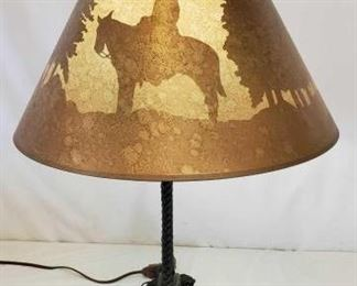 456	  Cowboy Spur Lamp with Western Scenes in Lamp Shade Cowboy Spur Lamp with Western Scenes in Lamp Shade.  Tested light and it works.