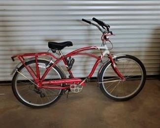 "99	  Bright Red Schwinn Bicycle Bright Red Schwinn Bicycle Adult size bike 26"" (Tire and Rim Measurement) Aluminum tubing Grip shift max Point Beach No air in tires Gel Seat 2 Cup Holders Cargo Rack on Rear Tire Model S4852WM Pacific Cycle  Date ESD03JG"