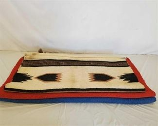 392	  3- Total Navajos, 1 Red Navajo Pad, 1 Royal Blue Navajo Pad, 1 Navajo Multi Colored Pad 1-Navajo Pad cream, taupe, black in color. Size 31x32. 1-Red Navajo Pad with basket weave wear leathers featuring a diamond silver conchos with horse hair tassel. Size 36x35 1-Royal Blue Navajo Pad with basket weave wear leathers featuring diamond silver conchos and horse hair tassel. Size 36x33. All navajos are in good using order, see pictures.
