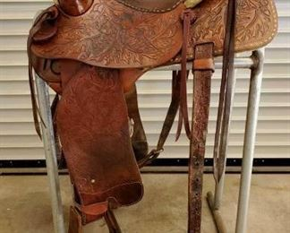"251	  Fallis Saddlery Monte Foreman Balanced Ride Buck Stitched Saddle w/ Matching Breast Collar 15 1/2"" Fallis Saddlery Monte Foreman Balanced Ride Saddle in good shape with full rigging. Serial # 587-3965.Large sterling silver horn cap.  The Balance Ride Design came about in 1954 The design was started in the John Fallis saddle shop (with Monte Foreman) but several saddle makers and saddle companies produced them under the Monte Foreman Balance Ride Design for several years, including Colorado Saddlery. Here is the web site to learn more. Has makers mark  www.fallisbalancedsaddles.com"