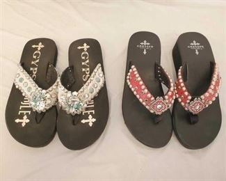 Two Pairs of Swarvoski Crystal Embellished Gypsy Soule Flip Flops Size 9 Hard to find Gypsy Soule Flip Flops 1- One pair of Crossed By Gypsy Soule Small Wedge Flip Flops in size 9. Featuring Red Gator straps with black diamond Swarovski crystals and silver dots. Custom concho in the center of the flip flop with red Swarovski crystals accents.  1- One pair of Gypsy Soule Flip Flops in size 9. Adorned with silver metallic hide, clear Swarovski crystals and turquoise stones on the straps. The center flower conchos are covered in both large and small clear Swarovski crystals and medium and small turquoise stones with silver dots lining the straps.  Both pairs are in excellent condition, one being brand new and one in like new condition.