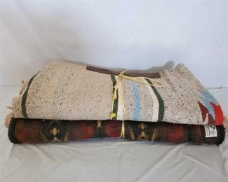 "504	  Four Used Saddle Pads Four used saddle pads: 1 Diamond Wool Saddle Pad 31"" 1 Cream colored Navajo Maytex Pad 1 Navajo Multi Colored Pad With Leather Wears 1 Misc Pad"