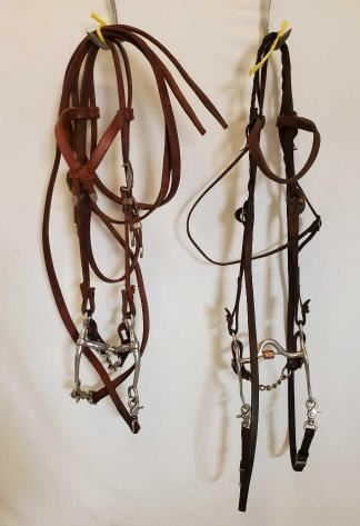 524	  2 Complete used Bridles 2 Complete Used Bridals: 1- Browband Headstall With Silverado Buckles And Tips Silver Overlay With Brass/Gold accents, with Tom Thumb Bit. 1-Browband Headstall with Partrade Correction Bit with Copper Roller Mouthpiece