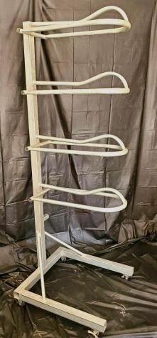 "4-Tier Steel Saddle Rack on Wheels with Wheel Locks  4-Tier Steel Saddle Rack on Wheels with wheel locks. These racks are just perfect for any tack room. In excellent shape and holds four saddles just perfect. Rack measures 73 1/2""x 26""x 28"" deep."