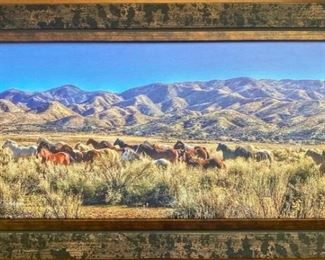 "Lot 44: ""Running Free"" Ranch life photography on canvas by Rhonda Graham  This print was taken on a bright winter day. Earl and I were out doing a livestock check and we had lots of wonderful visitors that came to see us. The picture was taken at the Las Flores Ranch in Summit Valley, Ca. Flores in Summit Valley, Ca. This print comes with a letter of authenticity, dated and signed by Rhonda Graham. Size; 24"" x 14"" including frame"