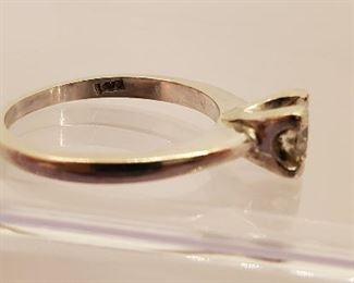 14k white gold and tested diamond ring