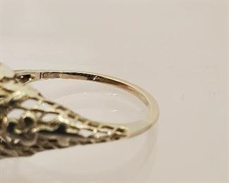 18 K white gold filigree ring with tested diamond