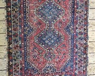 Antique Persian hand knotted rug