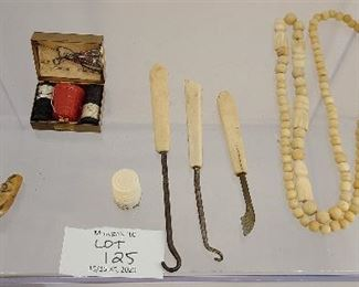 Mixed lot of antique bone button hooks, beads and souvenir of Alaska.