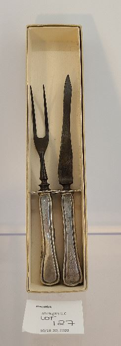 Antique Sterling Silver carving set of fork and knife please view for weight and size.
