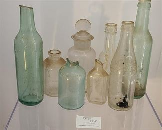 Mixed lot of antique of bottles dug out of the ground. Please view for condition and type of bottle.