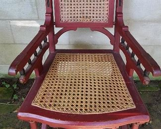 Antique gothic revival arm chair possibly walnut with replacement caned seat, original paint.