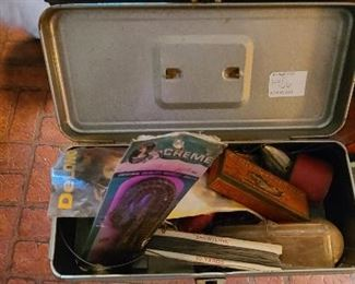 Mixed lot of small tackle box and various fishing lures and supplies.