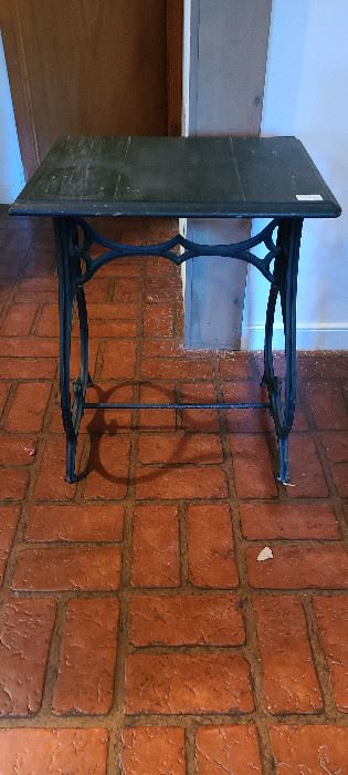 Small antique table with base from the Valentine Meat Juice Company