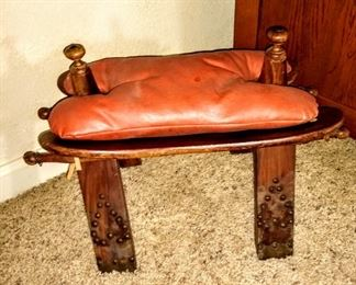 Antique camel saddle stool