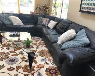 Black leather sectional sofa & rug