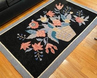 Pretty hooked floral rug.