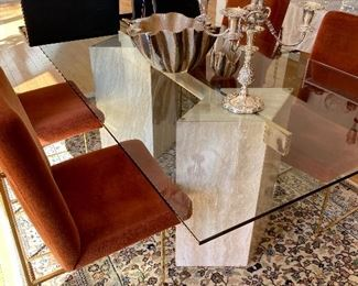Glass and travertine dining table.
