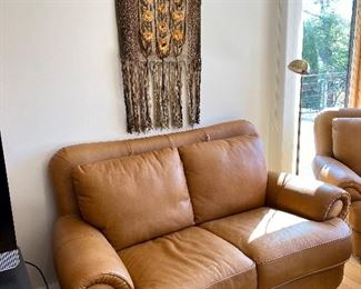 High quality Italian leather loveseat. Also has a matching chair and ottoman.