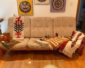 Mid century sofa, as well as several hand woven tapestries.