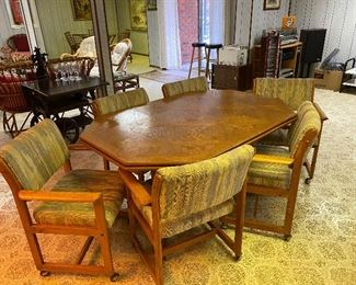 Oak conference table & six chairs on casters.