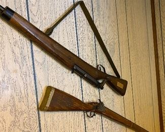 Toy wood rifles.