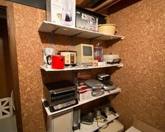 Small kitchen appliances, electronics and a Macintosh computer.
