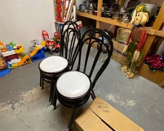 Four black metal cafe chairs,