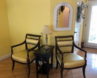 Two accent chairs, accent/lamp table with detailed top under glass and wall mirror