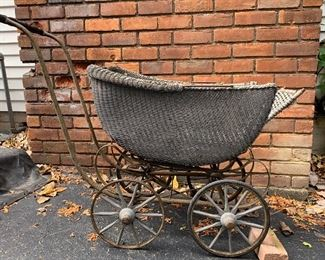 Antique baby carriage from 1920's. Made of wicker.  It's in good condition with some areas of wear.  It is in original condition.