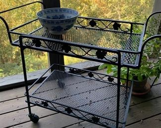 Rolling outdoor tea cart with removable top tray.