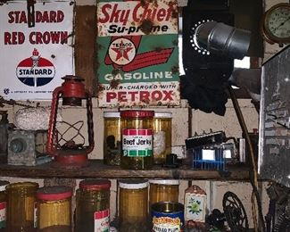 Vintage signs, license plates and oil cans.