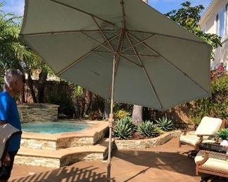 """tilting Treasure Gardens Umbrella and stand 123"""" Circumference - plus a second one 9' wide still in the box."""