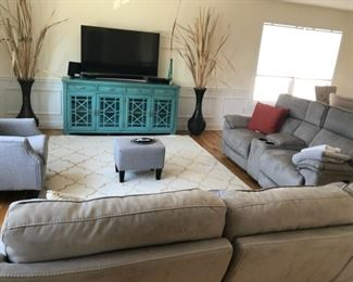 sofa is 7ft. 2 inches width 35.3 seater lounger pull out on both side usb on both sofas.  smaller  couch is 6'3inches 2 seaters width 35 with cup holder.  Tv is curved samsung 55 inches with sound bar and speaker