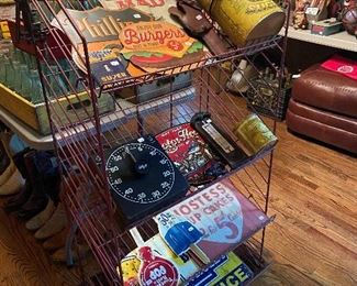 Vintage metal stand with 50's-60's replica signage.