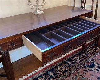 "Mahogany table, decorated on all sides, with on ""hidden"" felt lined silverware drawer"